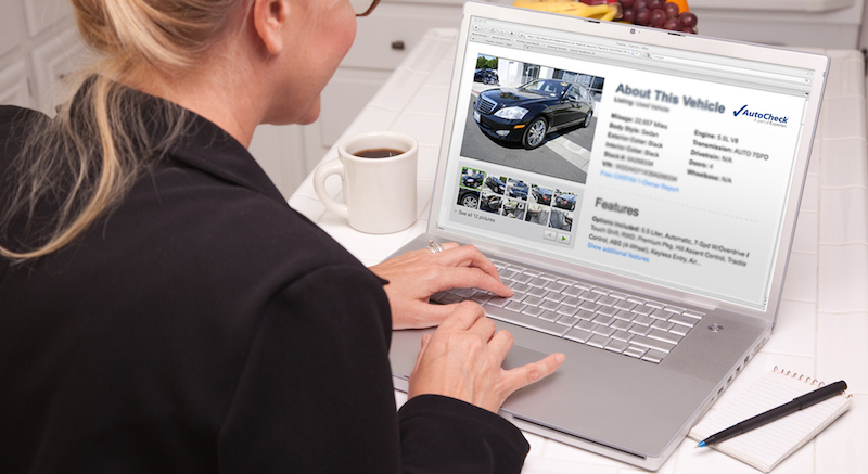 Online Car Shopping With Laptop